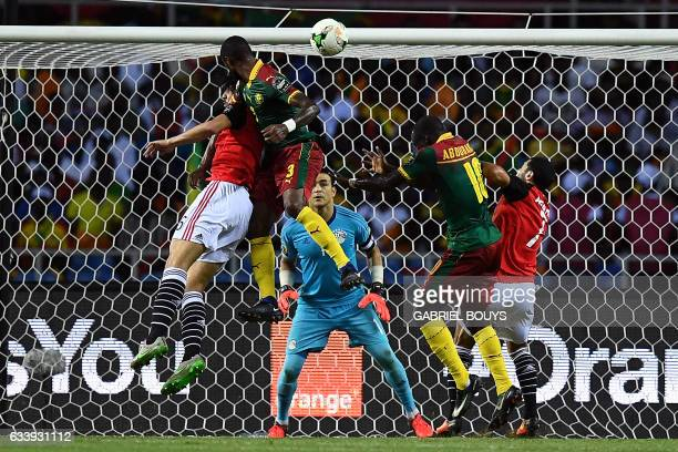 TOPSHOT Cameroon's defender Nicolas Nkoulou heads the ball to score a goal during the 2017 Africa Cup of Nations final football match between Egypt...