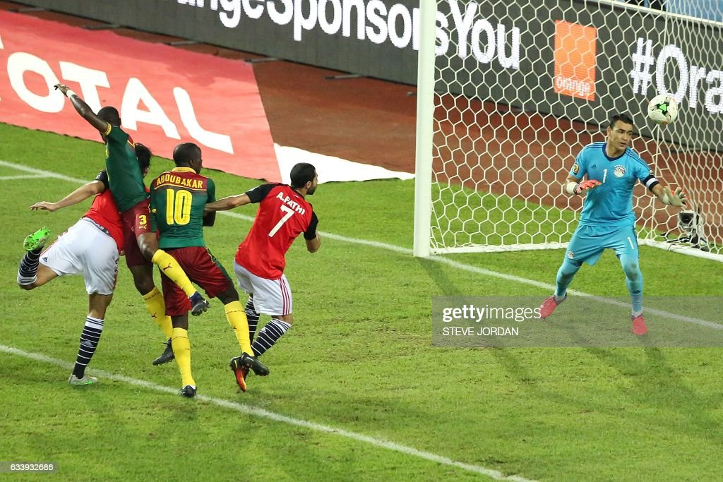 Cameroon's defender Nicolas Nkoulou (2nd L) heads the ball to score a goal during the 2017 Africa Cup of Nations final football match between Egypt and Cameroon at the Stade de l'Amitie Sino-Gabonaise in Libreville on February 5, 2017. / AFP / Steve JORDAN