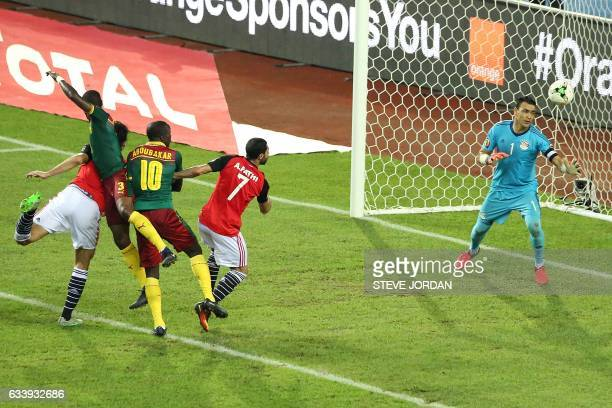 Cameroon's defender Nicolas Nkoulou heads the ball to score a goal during the 2017 Africa Cup of Nations final football match between Egypt and...