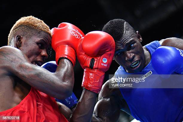 TOPSHOT Cameroon's Dieudonne Wilfred Seyi Ntsengue fights Colombia's Jorge Luis Vivas during the Men's Middle match at the Rio 2016 Olympic Games at...