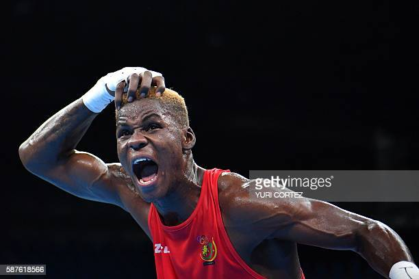 TOPSHOT Cameroon's Dieudonne Wilfred Seyi Ntsengue reacts to winning against Colombia's Jorge Luis Vivas during the Men's Middle match at the Rio...