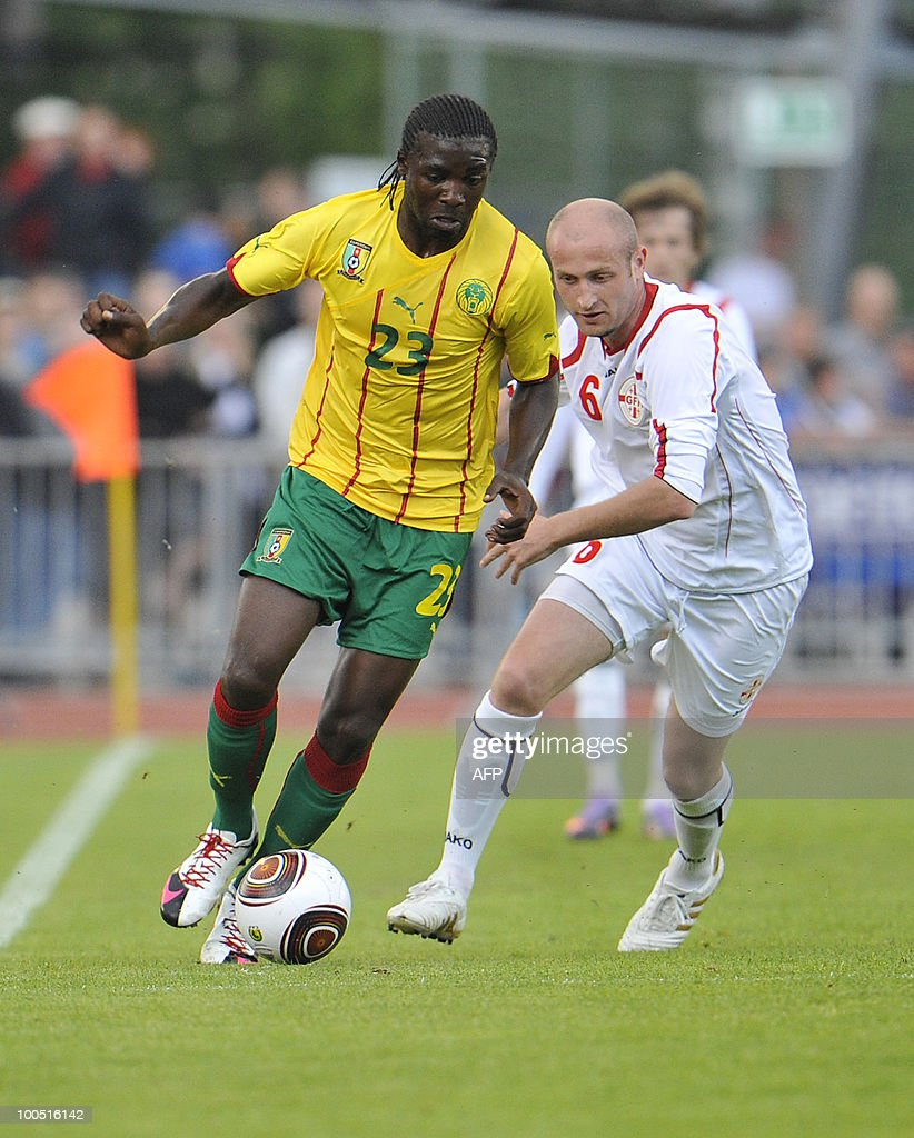 Cameroon's Dorge Kouemaha (L) tries to get the ball past Georgia's Aleksandre Amisulashvili during their international friendly football match in Lienz, on May 25, 2010. AFP PHOTO/Wildbild