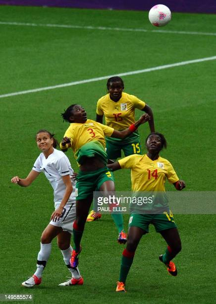 Cameroon's forward Ajara Nchout and defender Bibi Medoua compete with New Zealand's forward Amber Hearn next to Cameroon's Ysis Sonkeng during the...