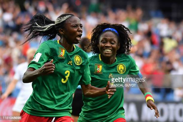 Cameroon's forward Ajara Nchout celebrates with Cameroon's forward Gabrielle Onguene after scoring her second goal during the France 2019 Women's...