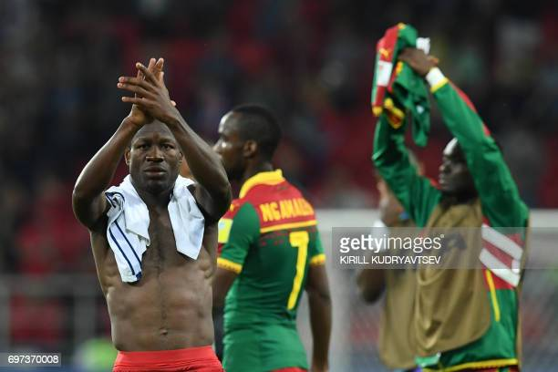 Cameroon's forward Christian Bassogog acknowledges supporters at the end of the 2017 Confederations Cup group B football match between Cameroon and...