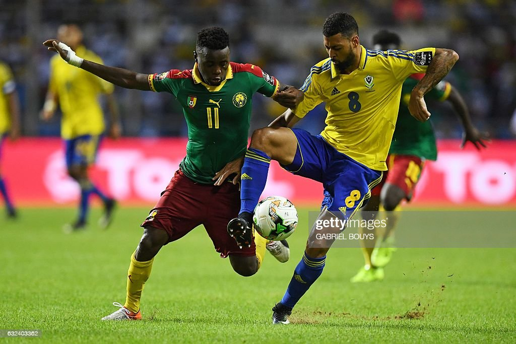 Cameroon's forward Edgar Salli (L) challenges Gabon's defender Lloyd Palun during the 2017 Africa Cup of Nations group A football match between Cameroon and Gabon at the Stade de l'Amitie Sino-Gabonaise in Libreville on January 22, 2017. / AFP / GABRIEL