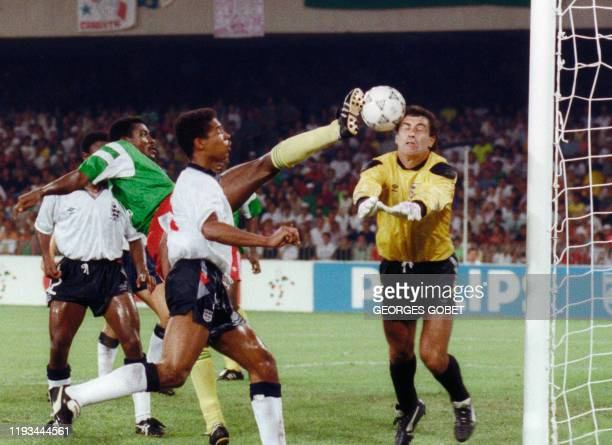 Cameroon's forward François Omam Biyik tries to kick the ball past English goalkeeper Peter Shilton as he moves in to block it during the World Cup...