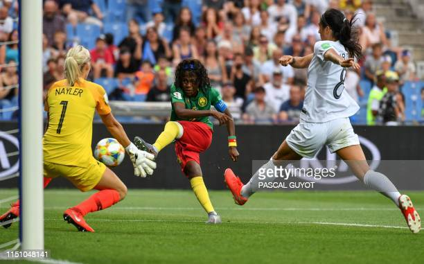 TOPSHOT Cameroon's forward Gabrielle Onguene kicks to the goal as New Zealand's goalkeeper Erin Nayler goes to block it during the France 2019...