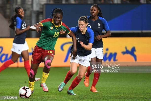 Cameroon's forward Michaela Abam vies with France's midfielder Elise Bussaglia during the football friendly match between France women team and...