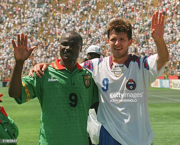 Cameroon's forward Roger Milla and Russian forward Oleg Salenko wave to the crowd after setting records in their Soccer World Cup match 28 June 1994...
