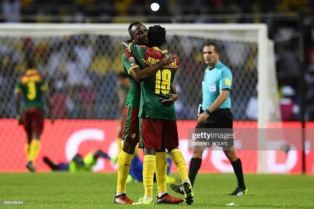 Cameroon's forward Vincent Aboubakar and Cameroon's midfielder Robert Ndip Tambe (R) celebrate at the end of the 2017 Africa Cup of Nations group A football match between Cameroon and Gabon at the Stade de l'Amitie Sino-Gabonaise in Libreville on January 22, 2017. / AFP / GABRIEL