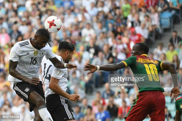 Cameroon's forward Vincent Aboubakar challenges Germany's defender Antonio Ruediger and Germany's midfielder Emre Can during the 2017 FIFA...