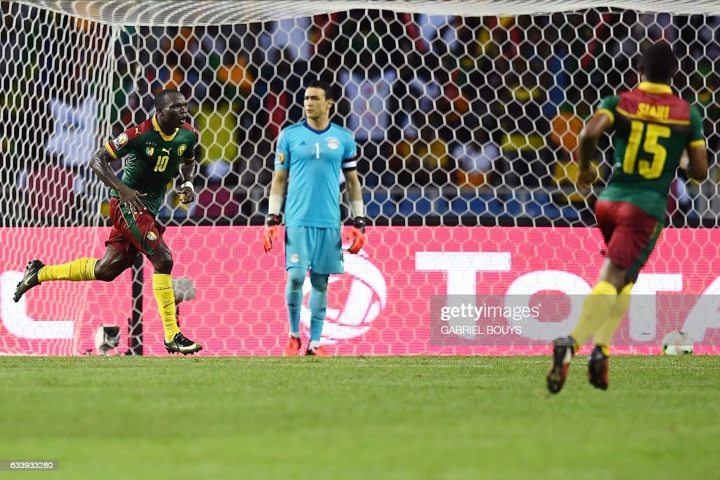 Cameroon's forward Vincent Aboubakar (L) reacts after scoring the team's second goal during the 2017 Africa Cup of Nations final football match between Egypt and Cameroon at the Stade de l'Amitie Sino-Gabonaise in Libreville on February 5, 2017. / AFP / GABRIEL