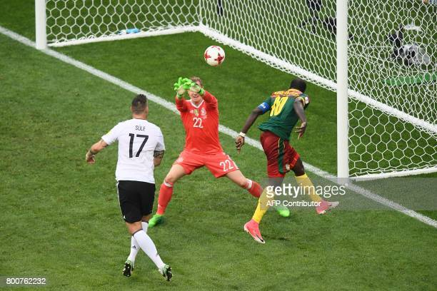 Cameroon's forward Vincent Aboubakar scores a header past Germany's goalkeeper MarcAndre Ter Stegen during the 2017 FIFA Confederations Cup group B...