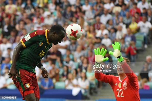 TOPSHOT Cameroon's forward Vincent Aboubakar scores a header past Germany's goalkeeper MarcAndre Ter Stegen during the 2017 FIFA Confederations Cup...