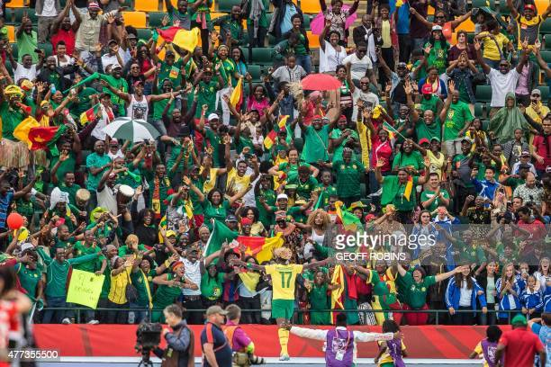 Cameroon's Gaelle Enganamouit celebrates her team's 21 win over Switzerland in their FIFA Women's World Cup group C match at Commonwealth Stadium in...