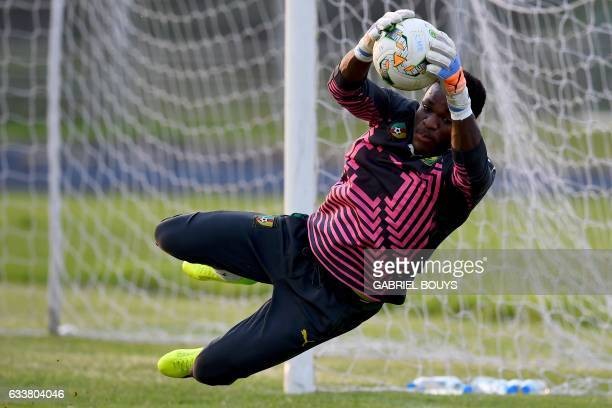 Cameroon's goalkeeper Fabrice Ondoa grabs the ball during a training session in Libreville on February 4 2017 on the eve of the final of the 2017...