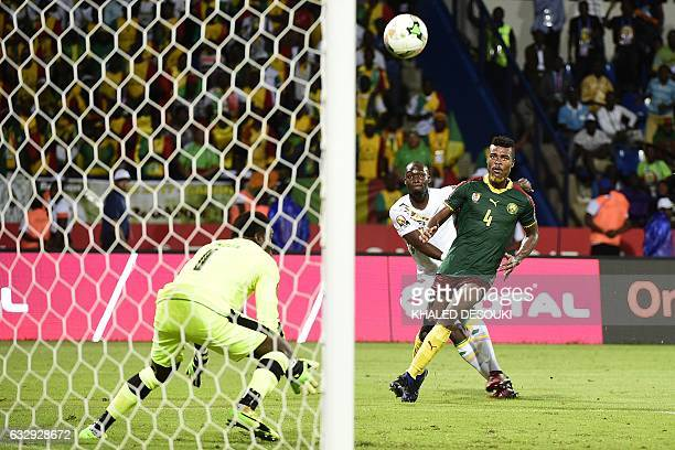 Cameroon's goalkeeper Fabrice Ondoa prepares to block a shot on goal by Senegal's defender Saliou Ciss next to Cameroon's defender Adolphe Teikeu...