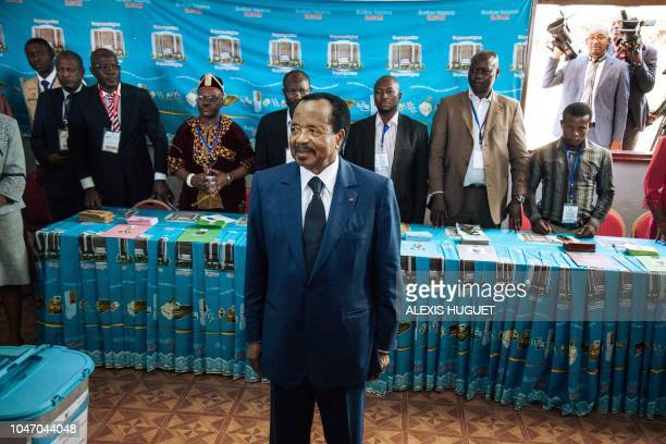 Cameroon's incumbent President Paul Biya looks on as he votes at the polling station in Bastos neighbourhood in the capital Yaounde, on October 7,...