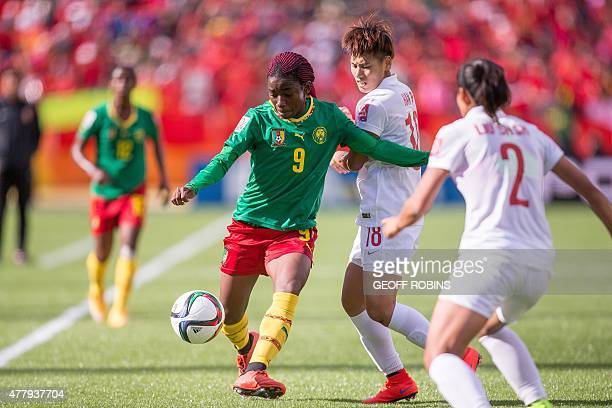 Cameroon's Madeleine Ngono Mani vies with China's Han Peng during their 2015 FIFA Women's World Cup football Group of 16 match between Cameroon and...