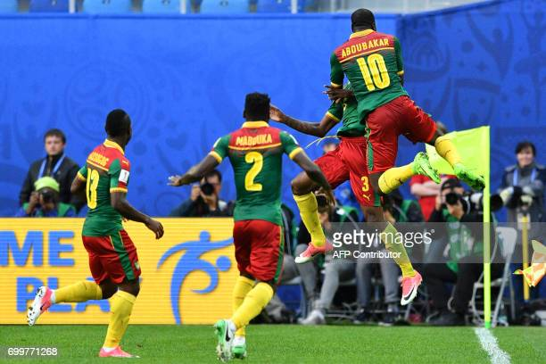Cameroon's midfielder Andre Zambo celebrates with teammates after scoring a goal during the 2017 Confederations Cup group B football match between...