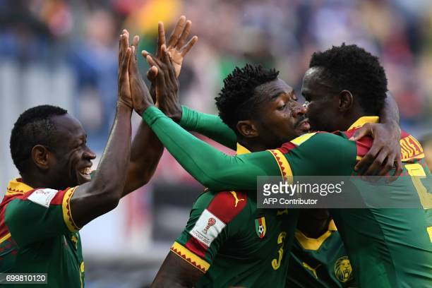 Cameroon's midfielder Andre Zambo is congratulated by Cameroon's defender Michael NgadeuNgadjui after he scored a goal during the 2017 Confederations...