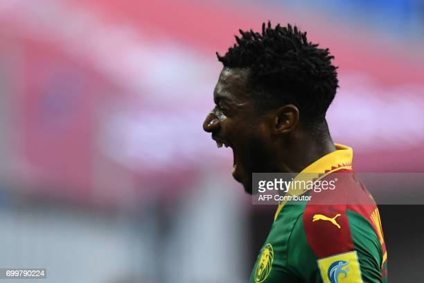 Cameroon's midfielder Andre Zambo reacts after scoring the match's first goal during the 2017 Confederations Cup group B football match between...