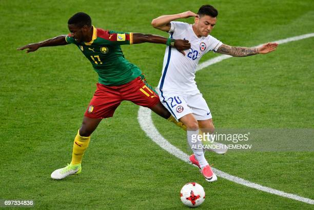 TOPSHOT Cameroon's midfielder Arnaud Djoum challenges Chile's midfielder Charles Aranguiz during the 2017 Confederations Cup group B football match...
