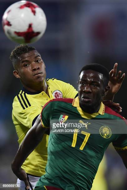 Cameroon's midfielder Arnaud Djoum vies with Colombia's midfielder Wilmar Barrios during the friendly football match Cameroon vs Colombia at the Col...