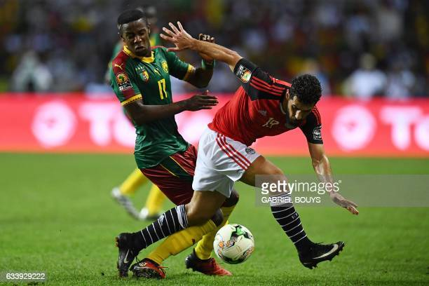 Cameroon's midfielder Arnaud SutchuinDjoum vies for the ball against Egypt's forward Abdallah Said during the 2017 Africa Cup of Nations final...