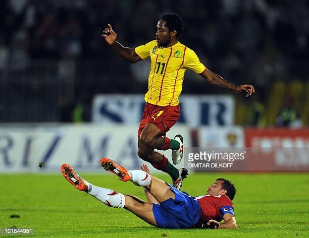 Cameroon's midfielder Jean Makoun jumps over Serbia's midfielder Dejan Stankovic during their friendly in Partizan stadium in Belgrade on June 5,...
