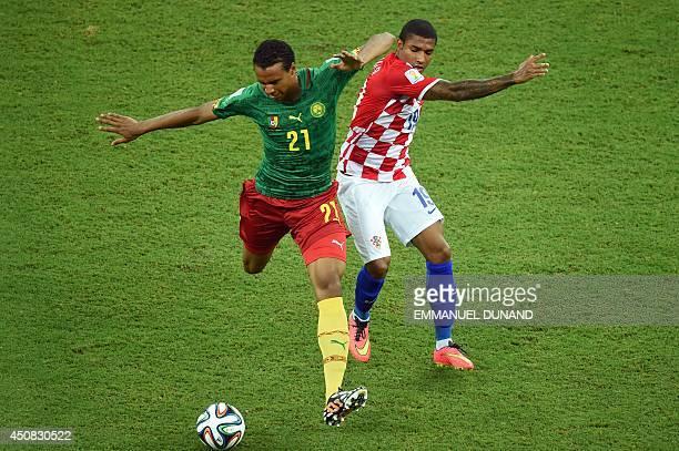 Cameroon's midfielder Joel Matip vies for the ball against Croatia's midfielder Sammir during a Group A football match between Cameroon and Croatia...
