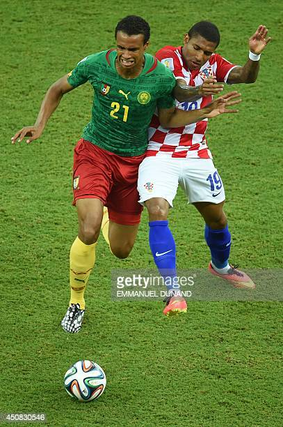 Cameroon's midfielder Joel Matip vies for the ball with Croatia's midfielder Sammir during a Group A football match between Cameroon and Croatia in...