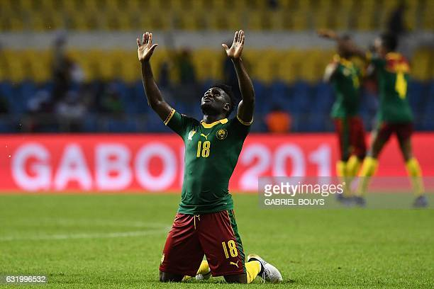 Cameroon's midfielder Robert Ndip Tambe celebrates at the end of the 2017 Africa Cup of Nations group A football match between Cameroon and...