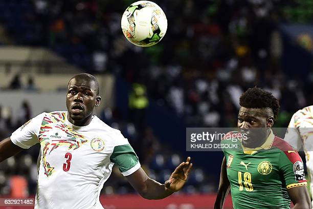 Cameroon's midfielder Robert Ndip Tambe challenges Senegal's defender Kalidou Koulibaly during the 2017 Africa Cup of Nations quarterfinal football...