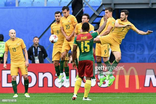 Cameroon's midfielder Sebastien Siani gestures as the Australian plays jump during a free kick in the 2017 Confederations Cup group B football match...