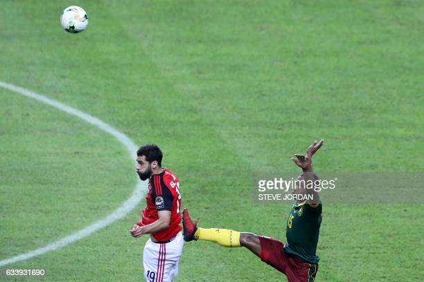 Cameroon's midfielder Sebastien Siani jumps for the ball against Egypt's forward Abdallah Said during the 2017 Africa Cup of Nations final football...