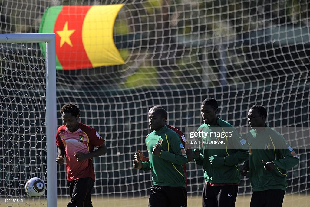Cameroon's national football players jog during a training session at Northlands School in Durban, on June 16, 2010 during the 2010 World Cup in South Africa.