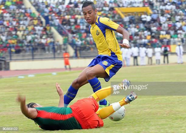 Cameroon's national football team player Benoit Assou duels for the ball with Gabon's national football team player Pierre Emeric Aubame on September...