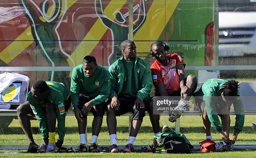 Cameroon's national football team players sitting on a bench get ready for a training session at Northlands School in Durban, on June 16, 2010. Cameroon's star striker Samuel Eto'o said on June 14 that the Group E clash against Denmark was a must-win game after the African side slipped to a 1-0 defeat against Japan.