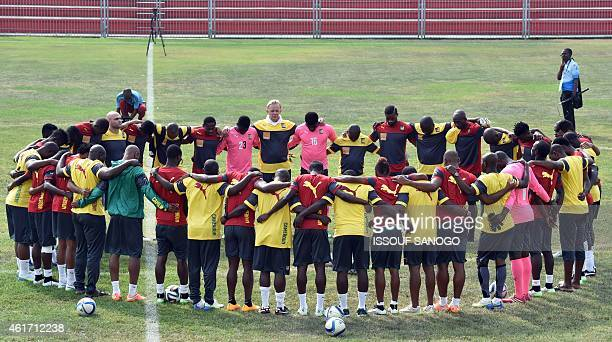 Cameroon's national football team's German head coach Volker Finke gathers with his players during a training session as part of their preparation...