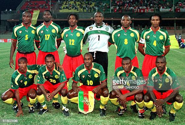 Cameroon's national soccer team poses for photographer 10 February 2000 before their game against Tunisia in the semifinal of the African Nations Cup...