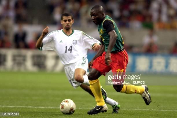 Cameroon's Pius Ndiefi goes past Saudi Arabia's Abdulaziz Khathran