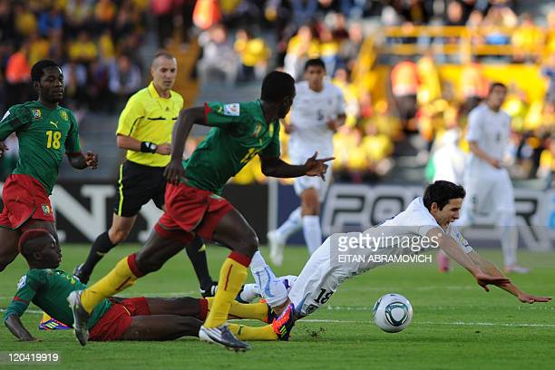 Cameroon's player Franck Ohandza fouls Uruguay's Carrillo Mayada during the FIFA U-20 World Cup, Group B first round football match held at the...
