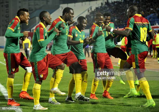 Cameroon's players celebrate after scoring during a friendly football match between Tunisia and Cameroon on March 24 2017 at the Ben Jannet stadium...