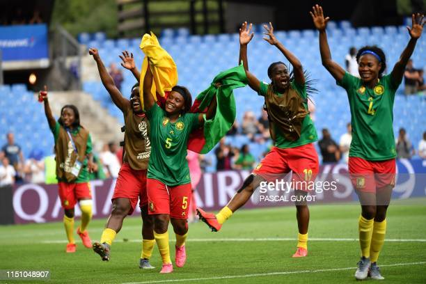 TOPSHOT Cameroon's players celebrate after winning the France 2019 Women's World Cup Group E football match between Cameroon and New Zealand on June...