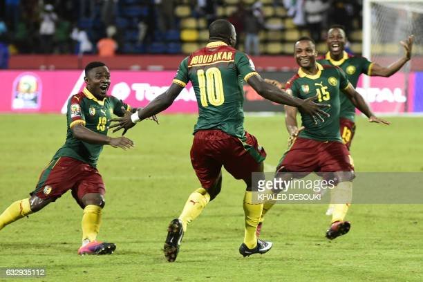 Cameroon's players celebrate after winning the penalty shootout at the end of the 2017 Africa Cup of Nations quarterfinal football match between...