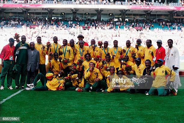 Cameroon's players celebrate their gold medal victory over Spain in the final of the 2000 Olympic tournament