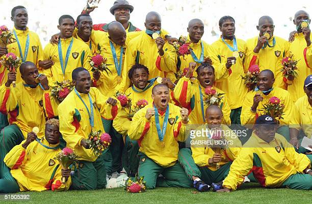 Cameroon's players display their medals after winning the gold medal in the soccer final match between Spain and Cameroon 30 September 2000 at the...