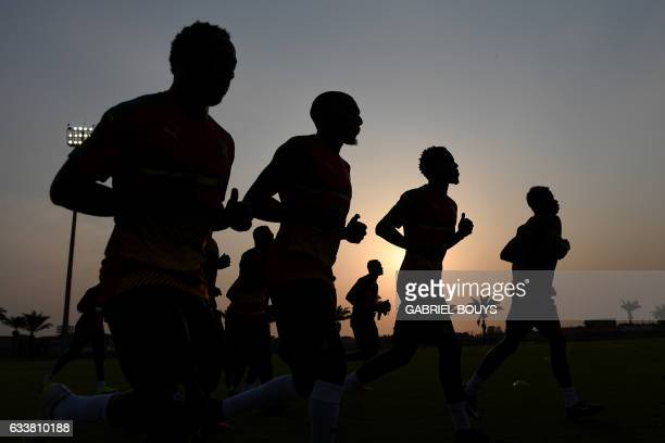 TOPSHOT Cameroon's players run during a training session in Libreville on February 4 2017 on the eve of the final of the 2017 Africa Cup of Nations...